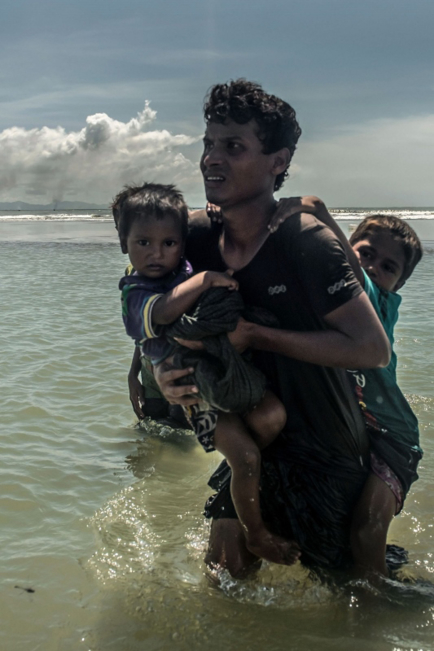 Rohingya Crisis Appeal - man carrying his son - Tommy Trenchard CI