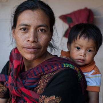 CAFOD works around with world with people like Santa Agripina with her baby Jansel. A CAFOD-supported mother and baby nutrition project saved baby Jansel's life by providing good quality food and advice for Santa.