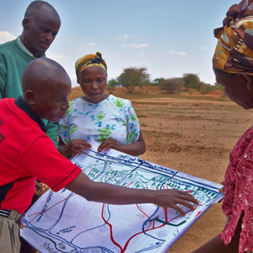 Members of the Kitui project checking the plans