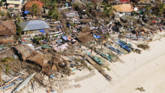 Damaged houses on a coastal community, after Typhoon Haiyan hit Iloilo Province,