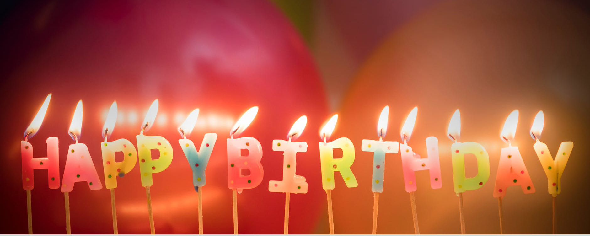Happy Birthday! Picture shows candles lit up and spelling out happy birthday. Could you celebrate this year with a fundraiser for CAFOD?