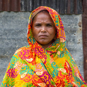 Mahinur outside her home.